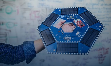 Ilan Stern, a GTRI senior research scientist, holds examples of the electronic components that will be used in piezoelectric tiles that will be used to create a lighted outdoor footpath at the NASA Kennedy Space Center's Visitor Complex at Cape Canaveral, Florida. The tiles are powered by piezoelectric components that generate current when they are compressed, flexed or vibrated. (Credit: Branden Camp, Georgia Tech Research Institute)