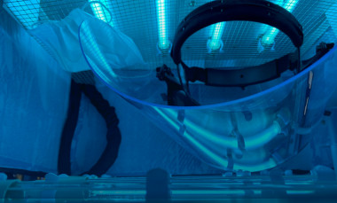 The portable UV disinfection chamber was designed to accommodate at least one face shield, along with multiple face masks. Mercury vapor tubes on both sides provide ultraviolet light to disinfect the PPE. (Credit: Robert Harris)