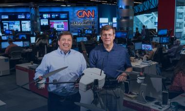 Shown in CNN's World Headquarters are (left) Greg Agvent, senior director of news operations for CNN, and Cliff Eckert, a GTRI senior research associate. They are working with an AirRobot AR 180 (Credit: Rob Felt, Georgia Tech)