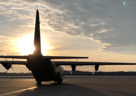 photo - C130J aircraft on the ground in silhouette with sunset