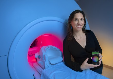 GTRI-Research-Associate-Megan-Denham-shows-a-smartphone-app-that-controls-lighting-around-an-MRI-simulator